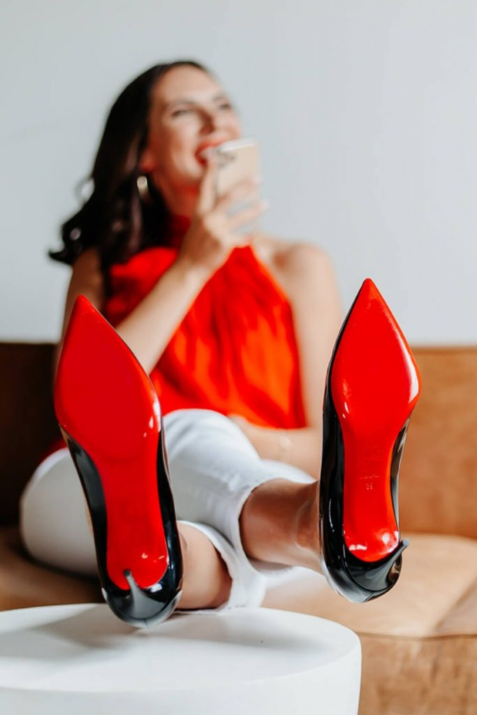 cait smiling with feet up - business coaching for women